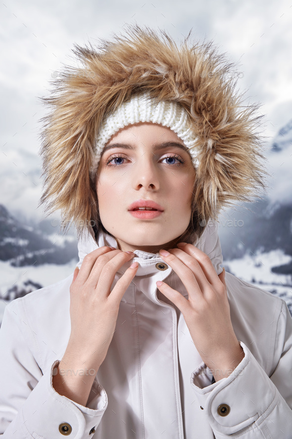 Portrait of of beautiful woman in winter clothes with fur - Stock Photo - Images
