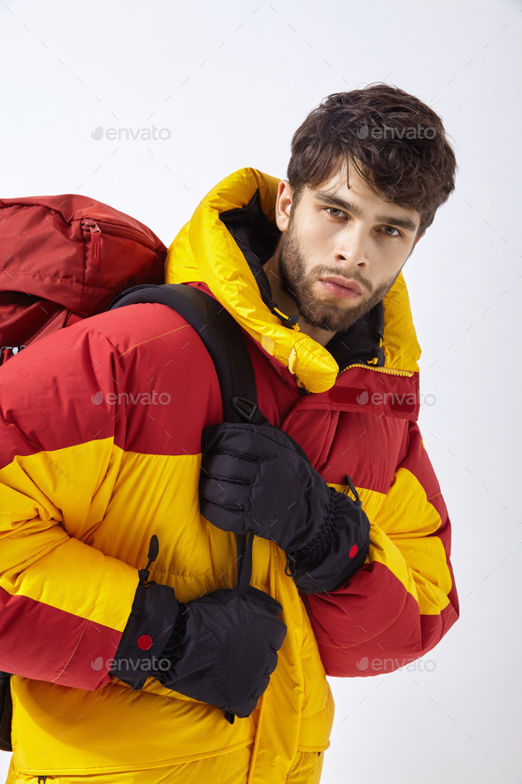 Mountaineer in winter clothes with hiking equipment on white isolated background - Stock Photo - Images
