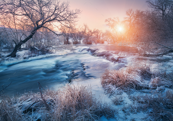 Winter landscape with snowy trees, ice, beautiful frozen river - Stock Photo - Images