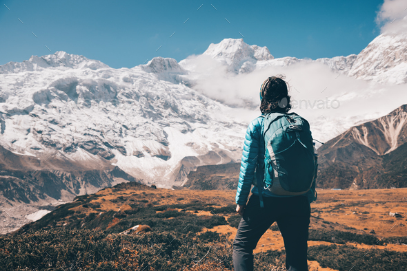 Woman on the stone and mountain valley - Stock Photo - Images