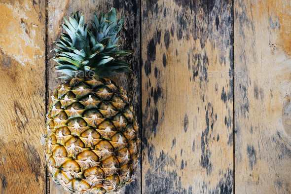 pineapple on the old wooden - Stock Photo - Images
