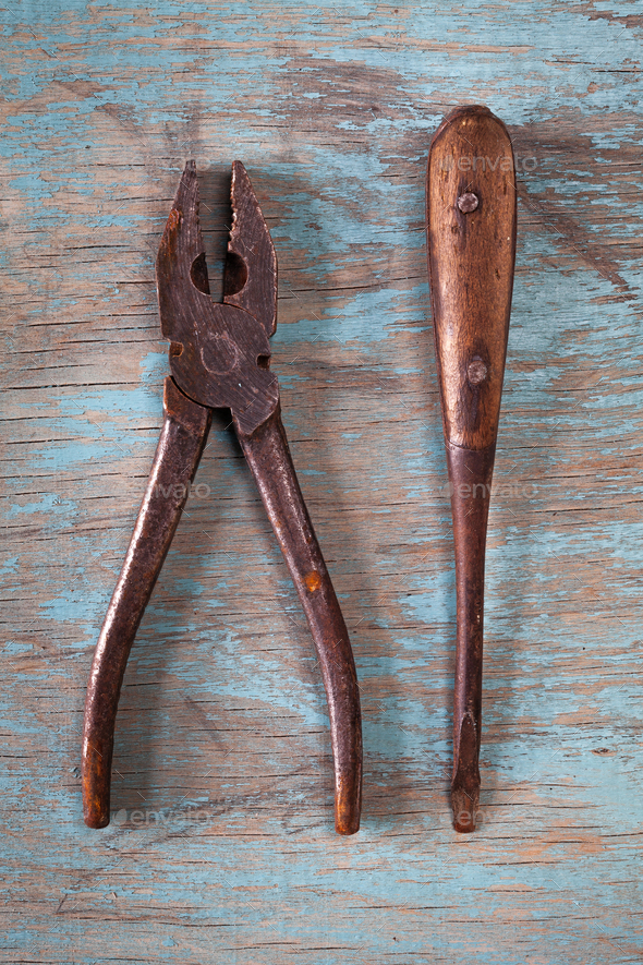Vintage tools on a blue wooden background - Stock Photo - Images