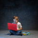 Little boy sitting with laptop in studio - PhotoDune Item for Sale