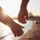 Two Lovers Joining Hands near the Sunset Lake - VideoHive Item for Sale