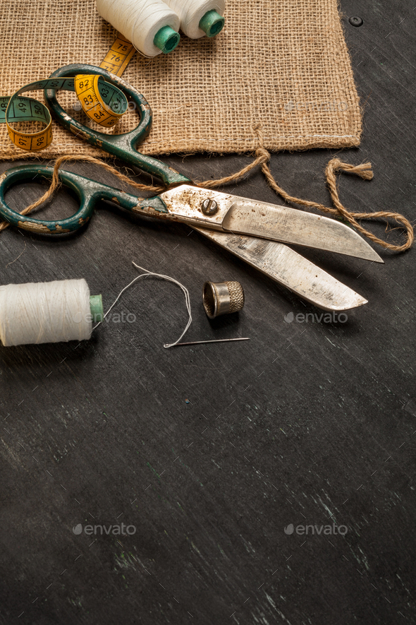 Retro sewing accessories on black wooden background - Stock Photo - Images