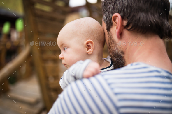 Father with little baby, summer day. - Stock Photo - Images