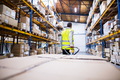 Male warehouse worker pulling a pallet truck. - PhotoDune Item for Sale
