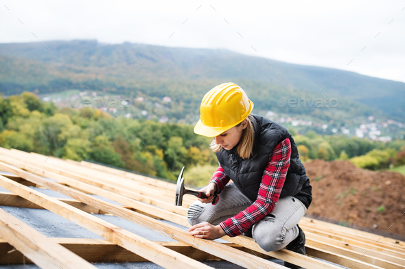 Young woman worker on the construction site. - Stock Photo - Images