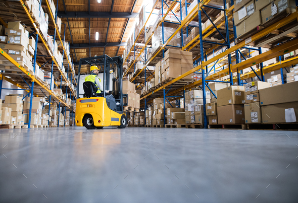 Warehouse man worker with forklift. - Stock Photo - Images