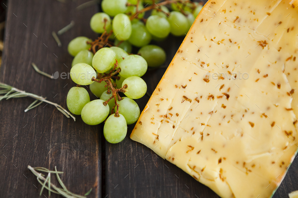 Gouda cheese with herbs closeup - Stock Photo - Images