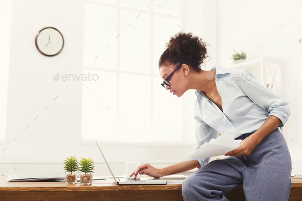 Business woman working with documents at office desktop - Stock Photo - Images