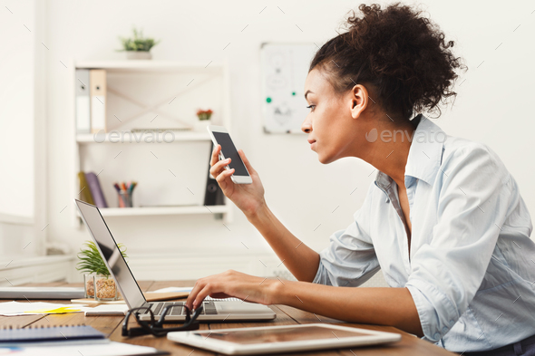 Business woman looking at smartphone - Stock Photo - Images