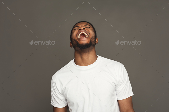 Facial expression, emotions, friendly black man laughing - Stock Photo - Images