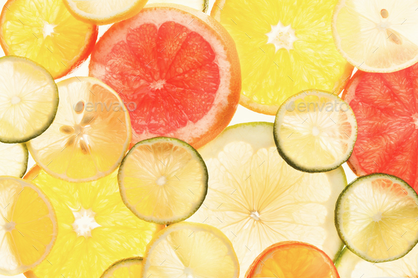 Backlit citrus fruits slices background - Stock Photo - Images
