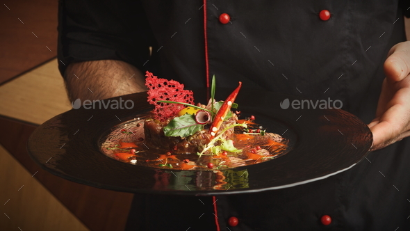 Modern restaurant dish. Veal tartare with quail egg - Stock Photo - Images