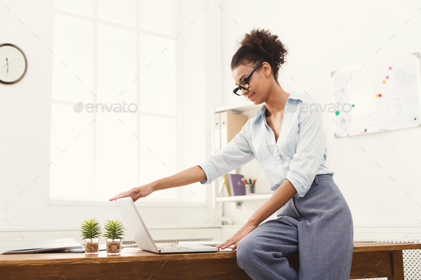 Business woman opening laptop at office - Stock Photo - Images