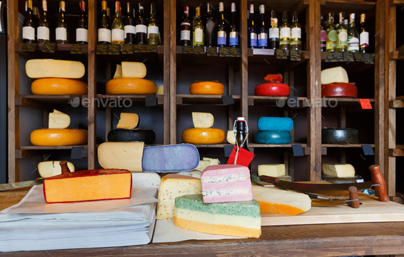 Grocery shop interior. Shelves and counter with cheese - Stock Photo - Images