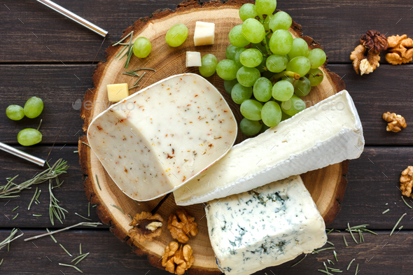 Cheese platter with fruits, homemade indian paneer - Stock Photo - Images
