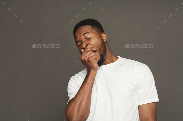 Facial expression, emotions, friendly black man yawning - Stock Photo - Images