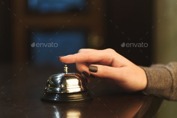 Woman ringing hotel reception service bell closeup - Stock Photo - Images