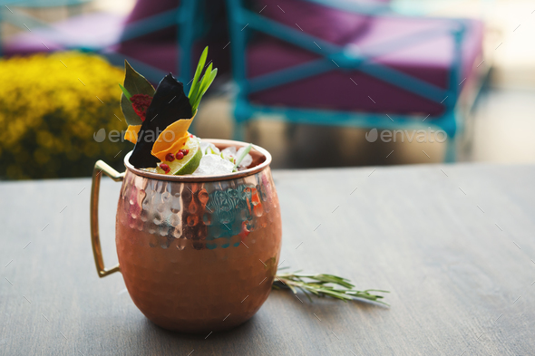 Moscow mule cocktail served on restaurant table - Stock Photo - Images