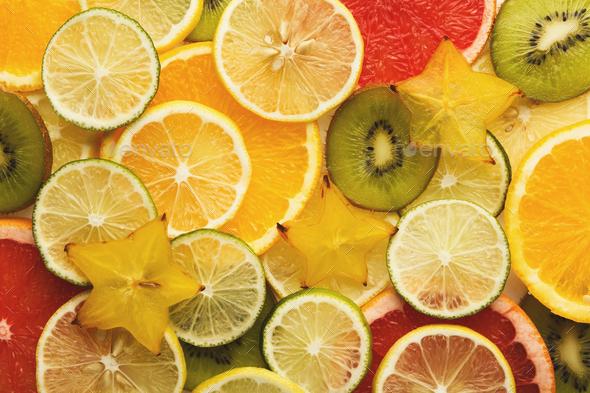 Exotic fruits slices background - Stock Photo - Images
