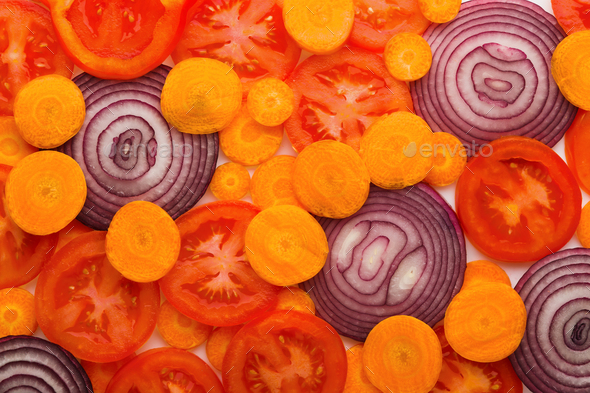 Colorful slices of tomatoes, carrots and onion - Stock Photo - Images