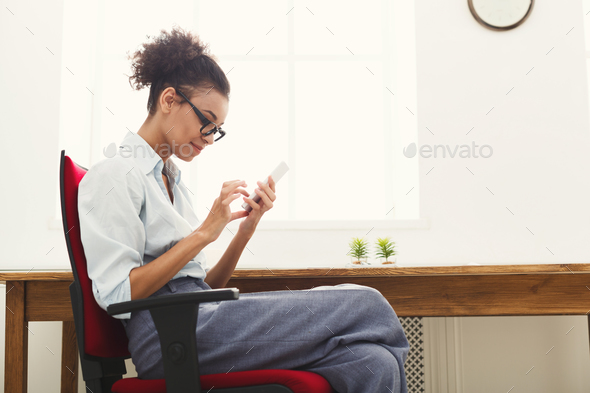 Business woman texting on smartphone - Stock Photo - Images