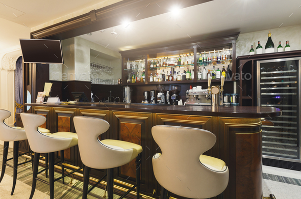 Hotel lounge bar with bottle shelfs and seats - Stock Photo - Images