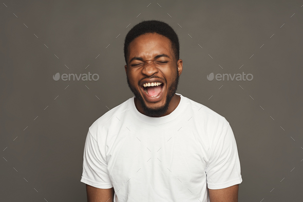 Black man expressing anger, feeling furious, shouting - Stock Photo - Images