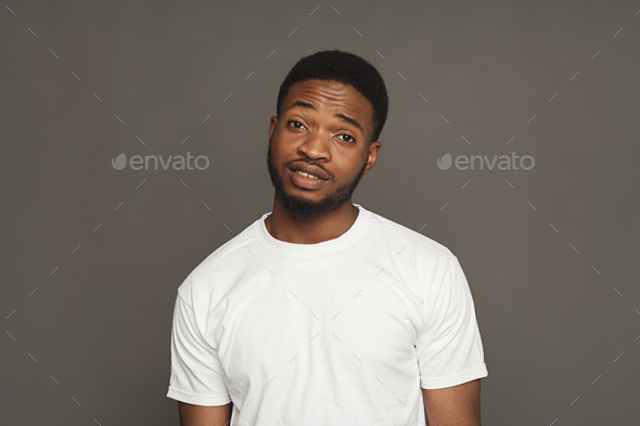 Inquiry facial expression, black man - Stock Photo - Images