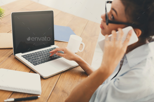 Business woman using laptop with blank screen - Stock Photo - Images
