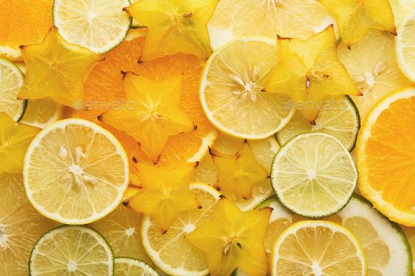 Backlit citrus fruits slices background - Stock Photo - Images