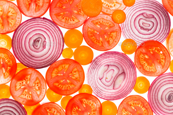 Backlit slices of tomatoes, carrots and onion - Stock Photo - Images