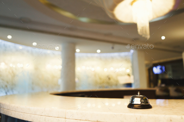 Hotel accommodation call bell on reception desk - Stock Photo - Images