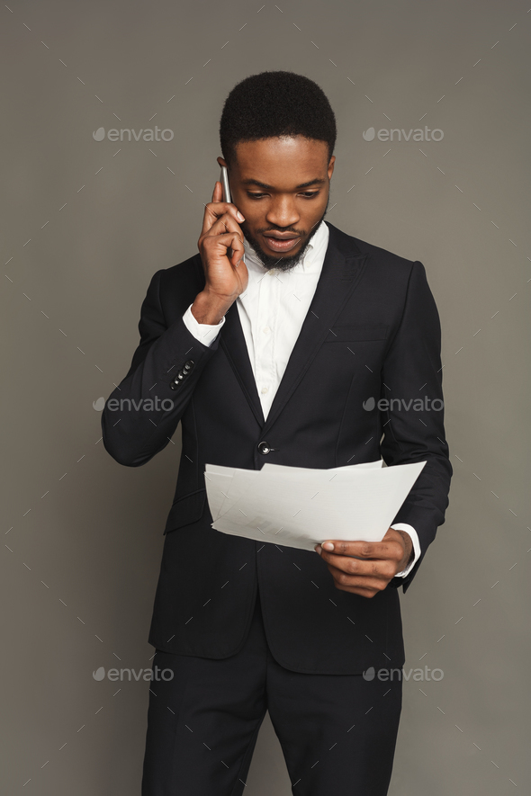 Handsome young black man portrait at studio background. - Stock Photo - Images
