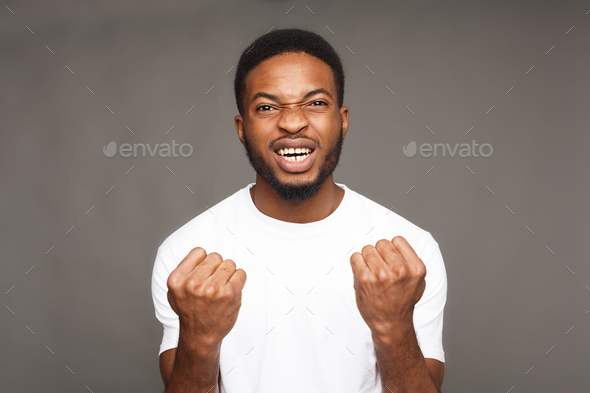 Success, excited black man with happy facial expression - Stock Photo - Images