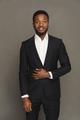 Handsome young black man portrait at studio background. - PhotoDune Item for Sale