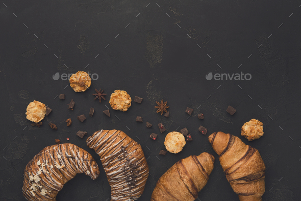 Homemade french croissants and cookies on wood - Stock Photo - Images