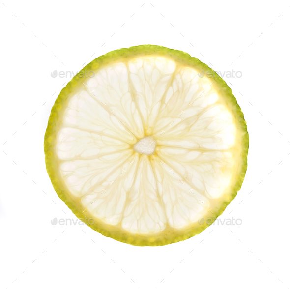 Green lime slice backlit, isolated on white - Stock Photo - Images