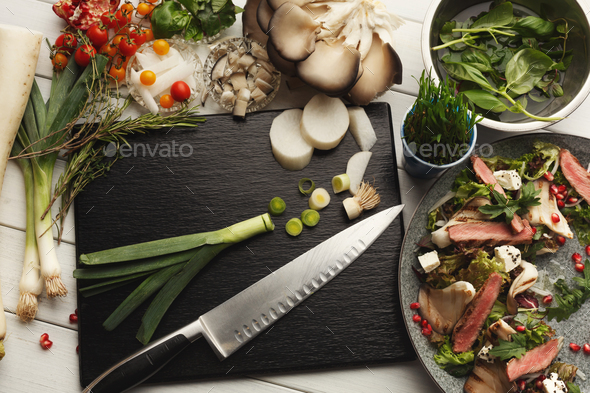 Warm mix salad with duck meat and mushrooms. Modern restaurant dish - Stock Photo - Images