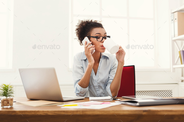 Business talk, woman consulting by phone at office - Stock Photo - Images