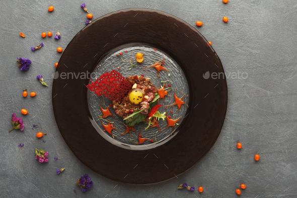 Modern restaurant dish. Veal tartare with quail egg closeup - Stock Photo - Images