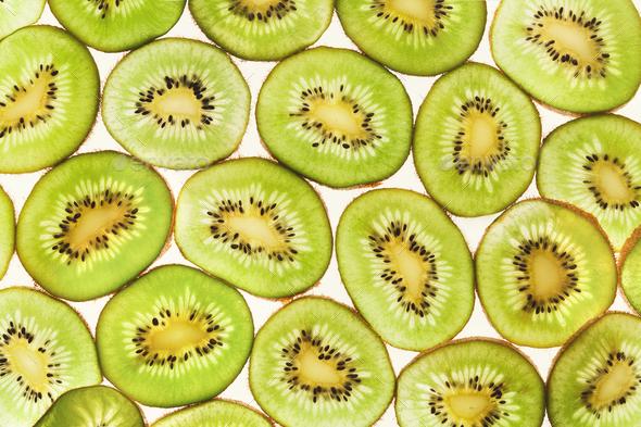 Backlit kiwifruit slices background - Stock Photo - Images