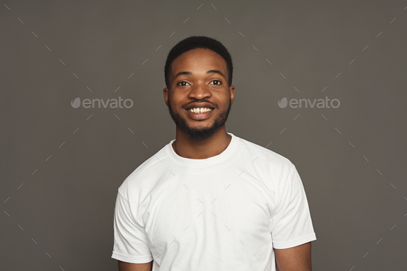 Facial expression, emotions, friendly black man smiling - Stock Photo - Images