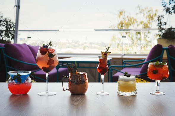 Variety of alcohol cocktails on gray table - Stock Photo - Images