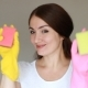 Portrait of a Young Woman in Yellow Rubber Gloves Looks at the Camera Smiling and Expresses Fatigue - VideoHive Item for Sale