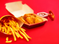 chicken nuggets and french fries on red background - PhotoDune Item for Sale