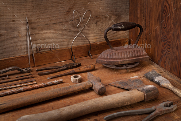 Collection of vintage tools on a blue wooden background - Stock Photo - Images