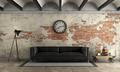 Black sofa in a grunge room - PhotoDune Item for Sale